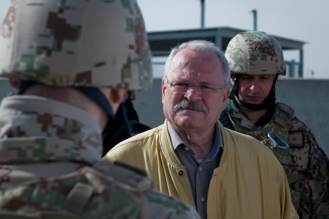 Slovak President Ivan Gasparovic receives an operations brief during his visit to the Slovak contingent Dec. 15 on Kandahar Airfield, Afghanistan.  (U.S. Army photo by Spc. Edward A. Garibay, 16th Mobile Public Affairs Detachment)