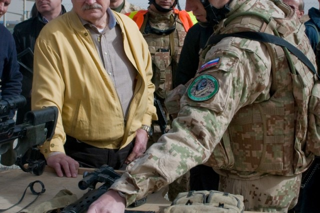 Ivan Gasparovic, President of Slovakia, receives a weapons familiarization briefing from his deployed soldiers during a visit to the Slovak contingent Dec. 15 at Kandahar Airfield, Afghanistan. (U.S. Army photo by Spc. Edward A. Garibay, 16th Mobile Public Affairs Detachment)