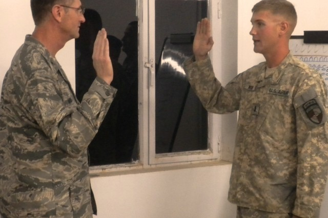 AF colonel promotes Army son in Afghanistan