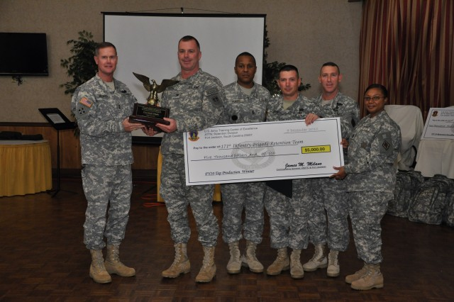Maj. Gen. James Milano, Fort Jackson's commanding general, left, presents Col. George Donovan, 171st Infantry Brigade commander, with the Top Producer award for re-enlistment during an awards luncheon Friday at the Officers' Club. Also pictured are, from left, 171st Inf. Bde. Command Sgt. Maj. William Huffin, Master Sgt. David Shannon, 171st Inf. Bde. senior career counselor, Post Command Sgt. Maj. Brian Stall, and Sgt. Maj. Jacqueline Lloyd, command career counselor.