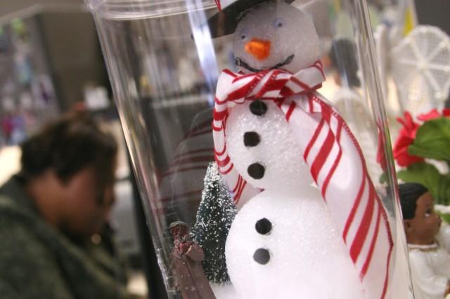 A snowman guards an employee's desk.