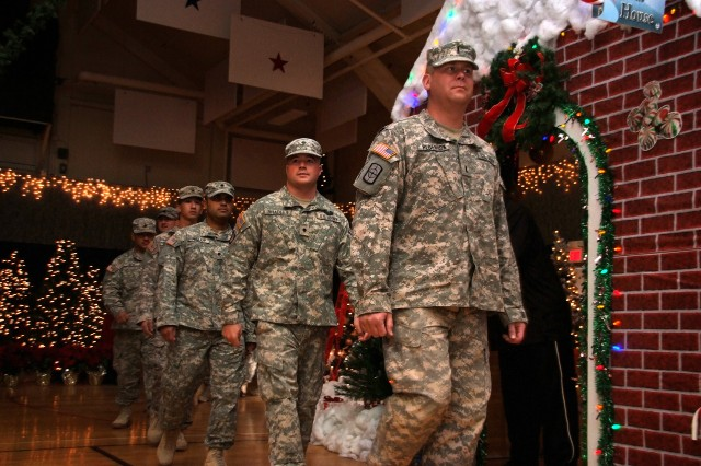 FORT CARSON, Colo. -- Reserve Soldiers march into the Special Events Center at Fort Carson Dec. 9 after a one-year deployment to Iraq.
