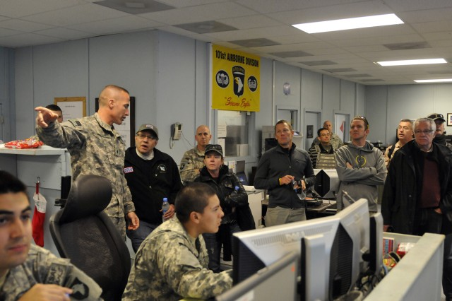 Comedians Lewis Black and Kathleen Madigan, along with athlete Lance Armstrong, tour several offices on Forward Operating Base Fenty, Afghanistan, during an USO tour, Dec. 15.