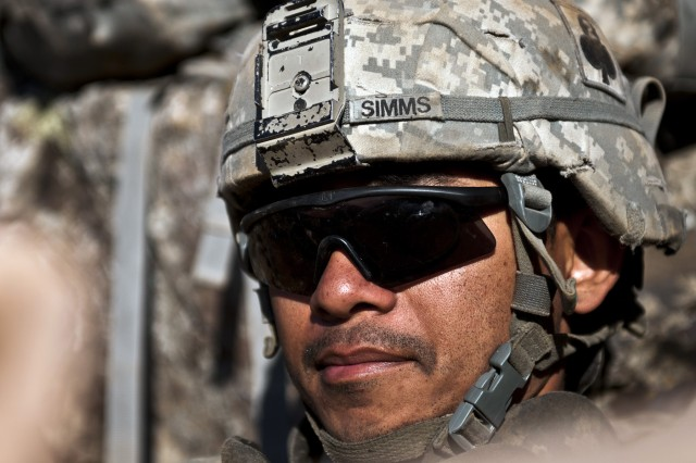 Pfc. Bruce S. Simms provides security from his fighting position on a mountainside overlooking the Ganjgal Valley, Afghanistan,  Dec. 11.