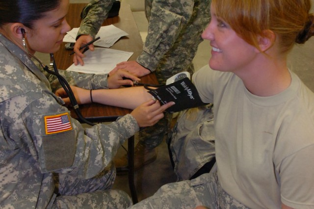 California IRR Soldier gets blood pressure checked