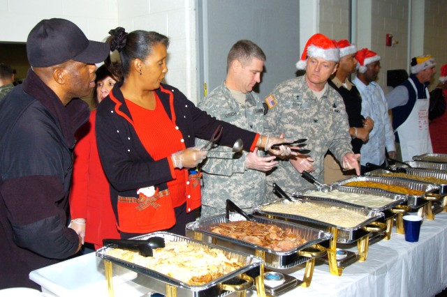 Servers finalize food preparations for the JFHQ NCR/MDW Holiday Social held at Fort McNair's gym 16 Dec., 2010.  Turkey, ham, stuffing and various types of deserts were served along with soft drinks and eggnog.  There was also an appearance from Santa, who presented a lucky few with gifts.  The social is an annual event and a chance for leadership to show its appreciation for the work members of the staff do during the year.