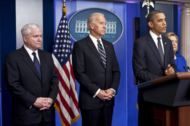 """Defense Secretary Robert M. Gates, left, and Vice President Joe Biden listen as President Barack Obama speaks on the Afghanistan-Pakistan Annual Review, describing the situation as """"a very difficult endeavor"""" but saying there has been """"significant progress,"""" at the White House, Dec. 16, 2010. White House photo by Pete Souza"""