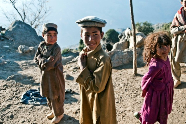 During the final phase of Operation Bulldog Bite in the mountains above the Pech River Valley in eastern Afghanistan's Kunar Province, three children look on inquisitively as Soldiers secure their village Nov. 23. The children were shy at first, but later opened up after they were handed food from Soldiers assigned to Company B, 1st Battalion, 327th Infantry Regiment, Task Force Bulldog, 1st Brigade Combat Team, 101st Airborne Division.