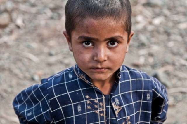 A boy in the village of Dag Mene in the Shalay Valley of eastern Afghanistan's Kunar Province curiously eyes the camera during a security patrol in the area Nov. 4. Soldiers from Company C, 2nd Battalion, 327th Infantry Regiment, Task Force No Slack, 1st Brigade Combat Team, 101st Airborne Division, cleared this village and spoke with the elders about security.