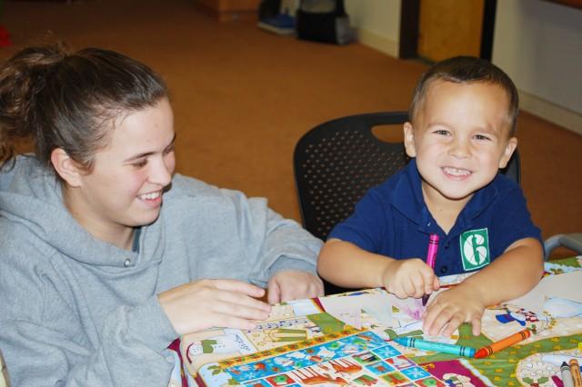 "SCHOFIELD BARRACKS, Hawaii - Felicia Rodkey and son Hunter Hoffman enjoy coloring at Army Community Service's ""Winter Wonderland"" event at Schofield Barracks, Tuesday."