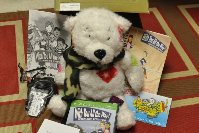The deployment kits, created by self-help author and motivational speaker Trevor Romain, were distributed to Barkley Elementary School students to help them cope while their Family members are deployed. The kits contain a DVD, stuffed animal and more.