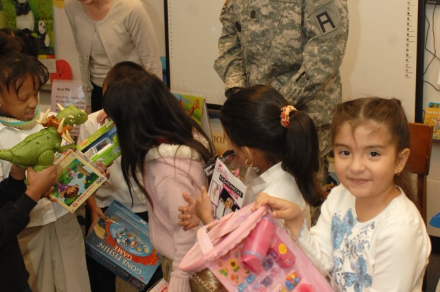 """Command Sgt. Maj. Jesse L. Andrews Jr., and Jimmie Ring, Assistant Chief of Staff, both of First Army, chat with second grade students at W.A. Fountain Elementary School during First Army's """"Operation Gift."""""""