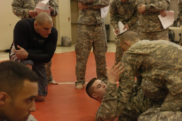 CORAOPOLIS,PA - Sgt. Aaron Magro, drill sergeant, 2/ 414th Inf. Regt., Salt Lake City, instructs Soldiers of the 316th Expeditionary Sustainment Command for level one combative training held at the 316th ESC Headquarters Dec. 13 through Dec. 17.  According to Magro the best part of being a combative instructor is when you can see the Soldiers catching on and grasping the concept of the lessons being taught.  (U.S. Army photo by Staff Sgt. Amber Greenlee, 316th ESC Headquarters' Public Affairs Office.)