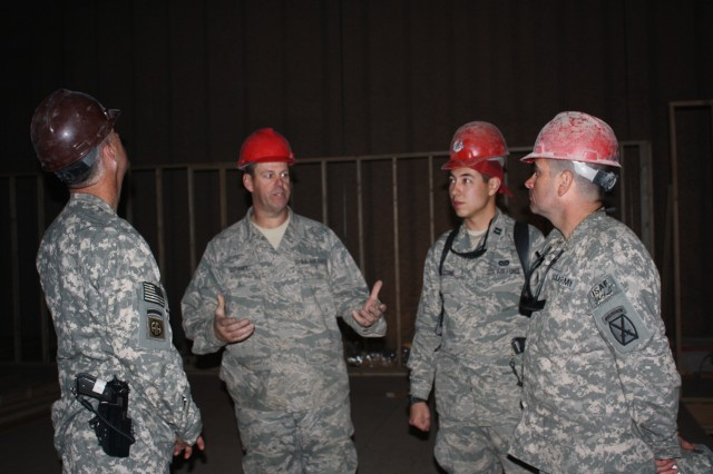 PARWAN PROVINCE, Afghanistan - Master Sgt. John Gurnsey, Air Force Red Horse cantonment sergeant, explains layout designs of Task Force Phoenix's future work space to Lt. Col. Dennis McKernan, Task Force Phoenix commander, and Task Force Phoenix's Command Sgt. Maj. Ronald Dvorsky on Dec. 10.  Lt. Col. McKernan, a native of Haddon Township, N.J., and Command Sgt. Maj. Dvorsky of Trumbull, Conn., expect to move into their new facility in the coming weeks.