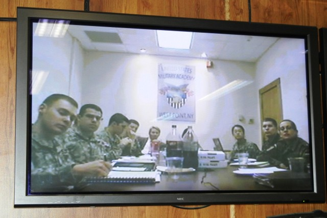 "West Point cadets listen in during a briefing led by Brig. Gen. John J. McGuiness, deputy commander for Regional Support, NTM-A and CSTC-A, given from Camp Eggers in Kabul.  McGuiness briefed the cadets on the mission in Afghanistan and was assisted by two other officers who spoke on the ""Rule of Law"" in Afghanistan."