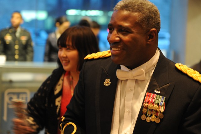 Chief Warrant Officer 4 Dewayne Kendricks, the commander and conductor of the 8th Army Band, prepares for the holiday concert at the Seoul Performing Arts Center Dec. 19.