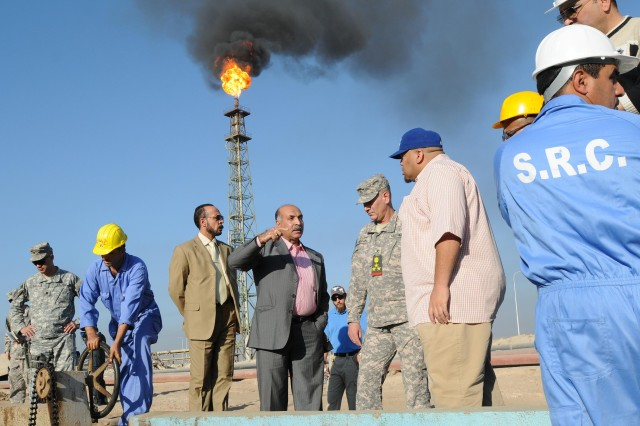 Abdl Husain Qasim, the South Refinery Company director general in Basra, provided a tour on company grounds to Brig. Gen. Randal Dragon, the deputy commanding general for support with the 1st Infantry Division and United States Division-South, and Barry Kountz, the senior oil advisor with the Basra Provincial Reconstruction Team.