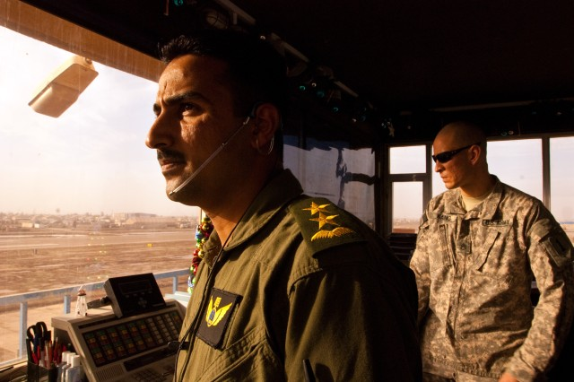An Iraqi air traffic controller scans the horizon around Camp Taji, Iraq, Dec. 15, while taking an occupational skills test. Soldiers with the 2nd General Support Aviation Battalion, 1st Aviation Regiment and civilian contractors from the Washington Consulting Group are working in Camp Taji's control tower to train the Iraqi soldiers. (U.S. Army photo by Spc. Roland Hale, eCAB, 1st Inf. Div. PAO)