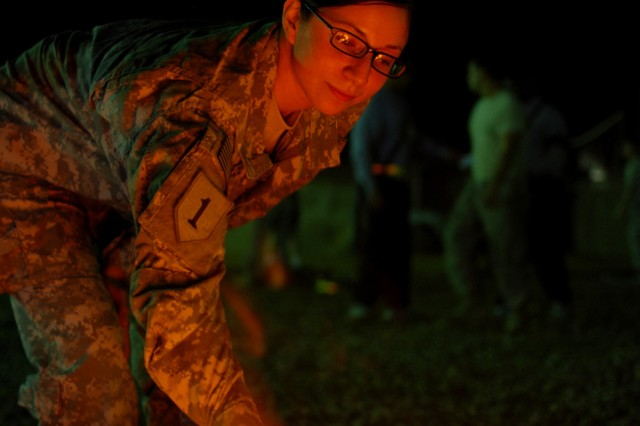 Spc. Anita Chacon, 20, of Fontana, Calif., cooks a s'more over a fire during a holiday party put on by her unit at Camp Taji, Iraq, Dec. 19. Chacon is serving her first deployment in Iraq with the Enhanced Combat Aviation Brigade, 1st Infantry Division. (U.S. Army photo by Spc. Roland Hale, eCAB, 1st Inf. Div. PAO)