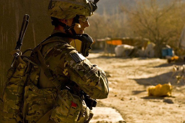 Sgt. Michael L. Zickefoose, a team leader assigned to Company B, 2nd Battalion, 30th Infantry Regiment, 4th Brigade Combat Team, 10th Mountain Division, provides security while keeping an eye on a recent avenue of approach Taliban used at the Charkh bazaar Dec. 11.