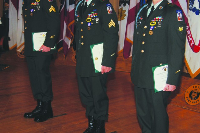 Sgt. Stuart Fredieu (left), Sgt. Coty Clare (center) and Spc. Ryan Guillot, Alpha Company, 1st Battalion (Airborne), 509th Infantry Regiment, receive Soldiers Medals during a ceremony Dec. 15 at Fort Polk's Bayou Theater. The Soldiers saved the life of an unconscious man trapped in a burning vehicle April 25.