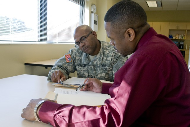 Master Sgt. Kenneth Greene, an inspector general non-commissioned officer and Jeffery Johnson, an assistant inspector general, look through paperwork while deciding the next step during an inspector general inquiry. Both Greene and Johnson are assigned to the 81st Regional Support Command inspector general staff at Fort Jackson, S.C.