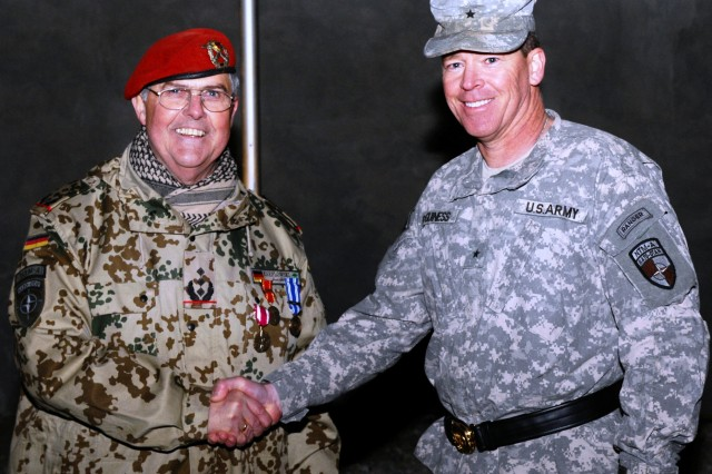 Col. Ralf Kneflowski is congratulated by Brig. Gen. John J. McGuiness during the ceremony at Camp Spann in northern Afghanistan.