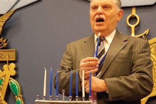 Pentagon and Arlington National Cemetery Rabbi Marvin I. Bash explains the meaning and significance of lighting the Hanukkah Menorah, prior to lighting candles at the Pentagon Hanukkah celebration in the Hall of Heroes Dec. 8.