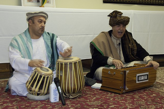 Afghan nationals play the harmonium and drums at a traditional Afghan dinner held during joint civilian-military training at Muscatatuck Urban Training Center, Indiana, Dec. 16.