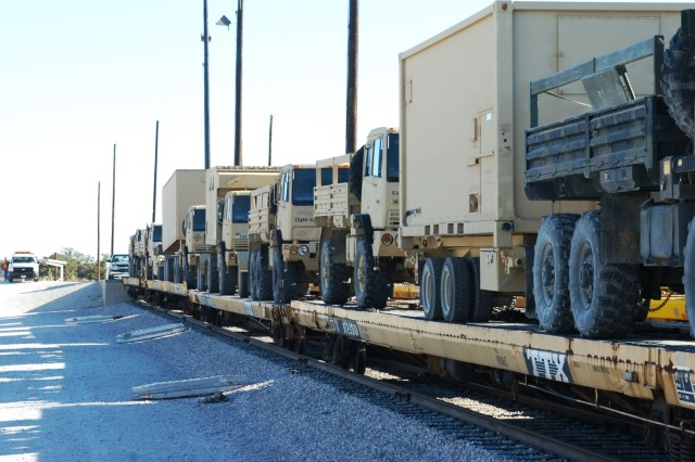 FORT HOOD, Texas- Various types of vehicles loaded on flatbed train cars wait to be shipped to the Joint Readiness Training Center in Fort Polk, La. The vehicles were loaded by Soldiers from the 2nd Brigade Combat Team, 1st Cavalry Division during the brigade's railhead operations on Fort Hood, Texas Dec. 10-14.