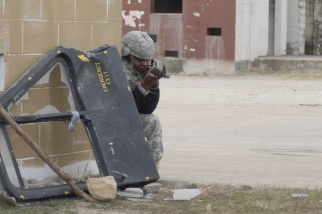 FORT HOOD, Texas - Spc. Nicholas Chepkwony, with Headquarters and Headquarters Battery, 2nd Battalion, 82nd Field Artillery Regiment, 3rd Brigade Combat Team, 1st Cavalry Division, pulls guard as the team waits for medical evacuation