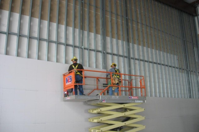 Blue Grass Chemical Agent-Destruction Pilot Plant workers continue to install interior wallboard and interior lighting within the Utility Building.