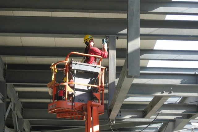 Blue Grass Chemical Agent-Destruction Pilot Plant workers install structural steel inside the Control and Support Building.