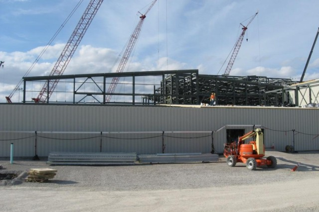 Blue Grass Chemical Agent-Destruction Pilot Plant workers continue to install roofing atop the Control and Support Building.