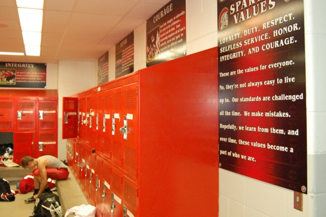 The male locker room at Somerset High School, Wis., displays an adaptation of the seven Army Values and the Warrior Ethos - known as the Spartan Values and the Spartan Creed. Coach Bruce Larson incorporated the values and ethos into his program because he said they form the most important part of developing a winning team.