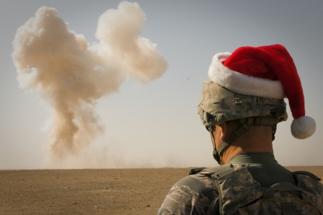 U.S. Airman watches explosion in Santa hat