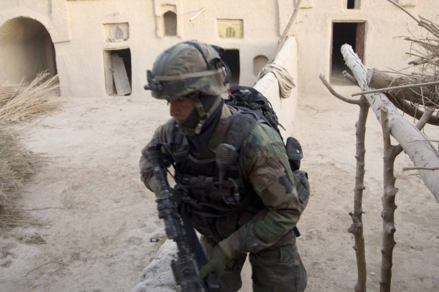 Sgt. Ibrahim, a 23-year-old native of Afghanistan's Baghlan Province and a squad leader with the 3rd Afghan National Army Commando Kandak, secures a compound during a two-day operation Dec. 19 and 20, 2010, in Zhari District, Kandahar Province, Afghanistan. The Commandos are partnered with members of Special Operations Task Force - South. (U.S. Army photo by Sgt. Ben Watson / Special Operations Task Force - South)(Released).