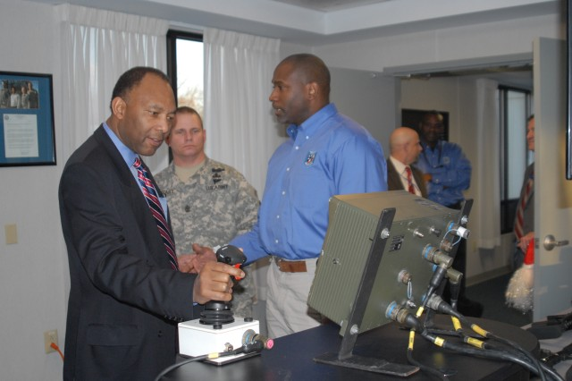 USASAC Deputy Robert Moore gets a hands-on demonstration as Sgt. Maj. William Kaundart looks on.