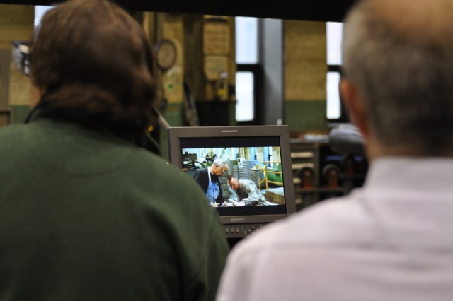 Film crewman, left,  and Arsenal Operations Director John Hockenbury observe the filming of machining operations at the Watervliet Arsenal.  The Arsenal is having four new videos developed to help it better market its production capabilities.