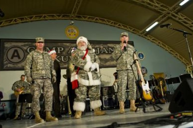 Lt. Gen. William G. Webster (right), Third Army commanding general; Sgt. Maj. of the Army Kenneth O. Preston (left), and Santa Claus speak with Soldiers during the Sergeant Major of the Army Hope and Freedom Tour at Camp Arifjan, Kuwait, Dec. 17.
