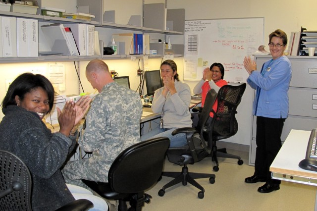 The Robertson Blood Donor Center staff applaud their success in the AABB certification process on Nov. 2, 2010, at Fort Hood, Texas.