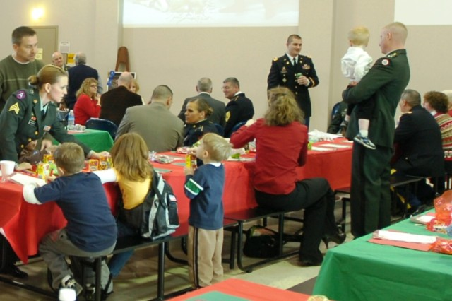 CORAOPOLIS, Pa. -- Soldiers of the 316th Expeditionary Sustainment Command gather with Family at the T/Sgt. Vernon T. McGarity United States Army Reserve Cen-ter Dec. 18 for a holiday celebration. Ac-tivities were provided for children, and Soldiers and Family members enjoyed a luncheon after the unit's awards presenta-tions. Soldiers were recognized for out-standing performance during their re-quired two-week annual training held this year at Fort McCoy, Wis.