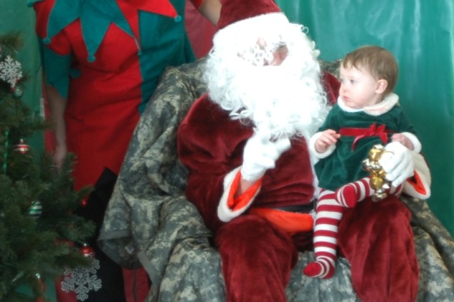 CORAOPOLIS, Pa. -- Sgt. Francis Manning dresses as an elf, while a family member of a Soldier plays Santa for Family Day here Dec. 18. Children of service members lined up to sit on Santa's lap for photos and gifts. Sol-diers and Family members enjoyed a luncheon after the unit's award presentations, while activities were provided for children throughout the day. This event was organized and hosted by the 316th ESC Family Readiness Group. The group is run by Soldiers and Family members to pro-vide morale, welfare and recreational events for all mili-tary members and their Families within the command. The 316th ESC is an Army Reserve logistics headquar-ters. Over 11,000 Soldiers are assigned to the unit with operations from Virginia to Maine. Army Reserve logis-tics' Soldiers handle supply operations, ammunition stor-age, transportation and food service duties to support the Active Army. The command was last deployed in 2008 to support Operation Iraqi Freedom.