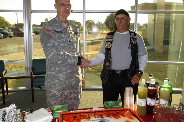 Lt. Col. Dennis Dombrowski presents Ron Decker with an Armed Services Blood Program coin at the Robertson Blood Center at Fort Hood on October 20, 2010.