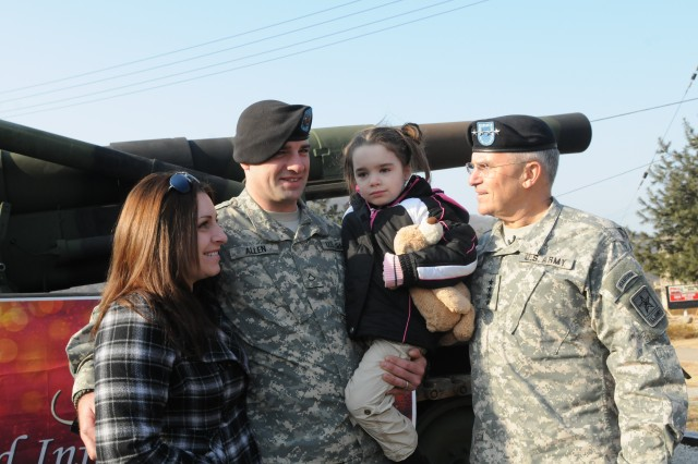 Gen. George Casey shares a moment with Pvt. First Class Patrick Allen, his wife Danielle, and daughter Denver. Allen is stationed at Camp Casey, South Korea with the 2nd Infantry Division.