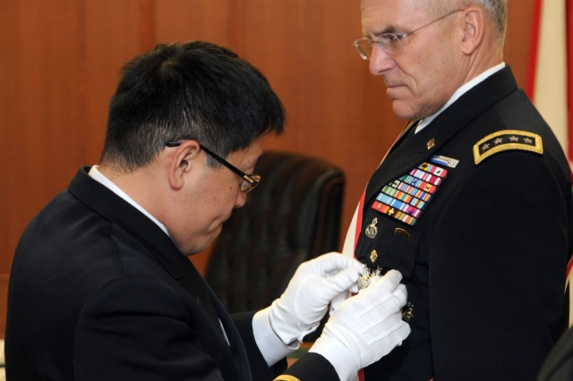 Gen. George W. Casey Jr., right, chief of staff of the U.S. Army, is awarded the Order of the Rising Sun during a Dec. 21 ceremony presided over by Japanese Defense Minister Toshimi Kitazawa, held at the Japanese Ground Self-Defense Forces headquarters at Camp Ichigaya. The Order of the Rising Sun is Japan's second most prestigious decoration.