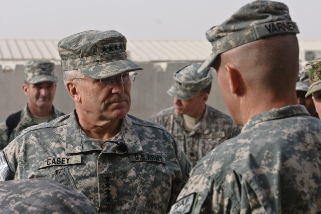 Chief of Staff of the Army Gen. George W. Casey Jr. greets Command Sgt. Maj. Randy S. Varner, 43rd Sustainment Brigade command sergeant major, before speaking with the Soldiers of the 43rd at Kandahar Airfield, Afghanistan, Dec. 23.