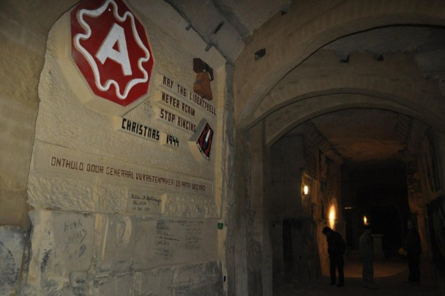 A tribute to the United States Ninth Army is carved in the wall of the De Schark Caves, Maastricht, where approximately 300 U.S. Service Memebers celebrated Christmas Eve in 1944. The southern Dutch province of Limburg was liberated exclusively by U.S. forces by the winter of 1944.