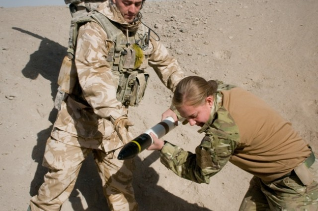 101222-A-5634G-003: U.S. Army and British forces place unserviceable rockets into a pit before destroying them Dec. 22, outside the perimeter of Kandahar Airfield, Afghanistan. (U.S. Army photo by Spc. Edward A. Garibay, 16th Mobile Public Affairs Detachment)