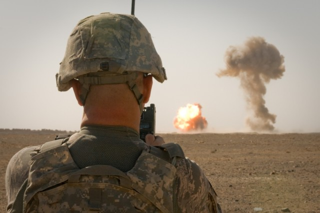 101222-A-5634G-007: U.S. Air Force Tech. Sgt. Robert L. Woods, 466th Air Expeditionary Group, EOD Flight team leader, detonates home-made explosives and expired ammunition Dec. 22, outside the perimeter of Kandahar Airfield, Afghanistan. (U.S. Army photo by Spc. Edward A. Garibay, 16th Mobile Public Affairs Detachment)